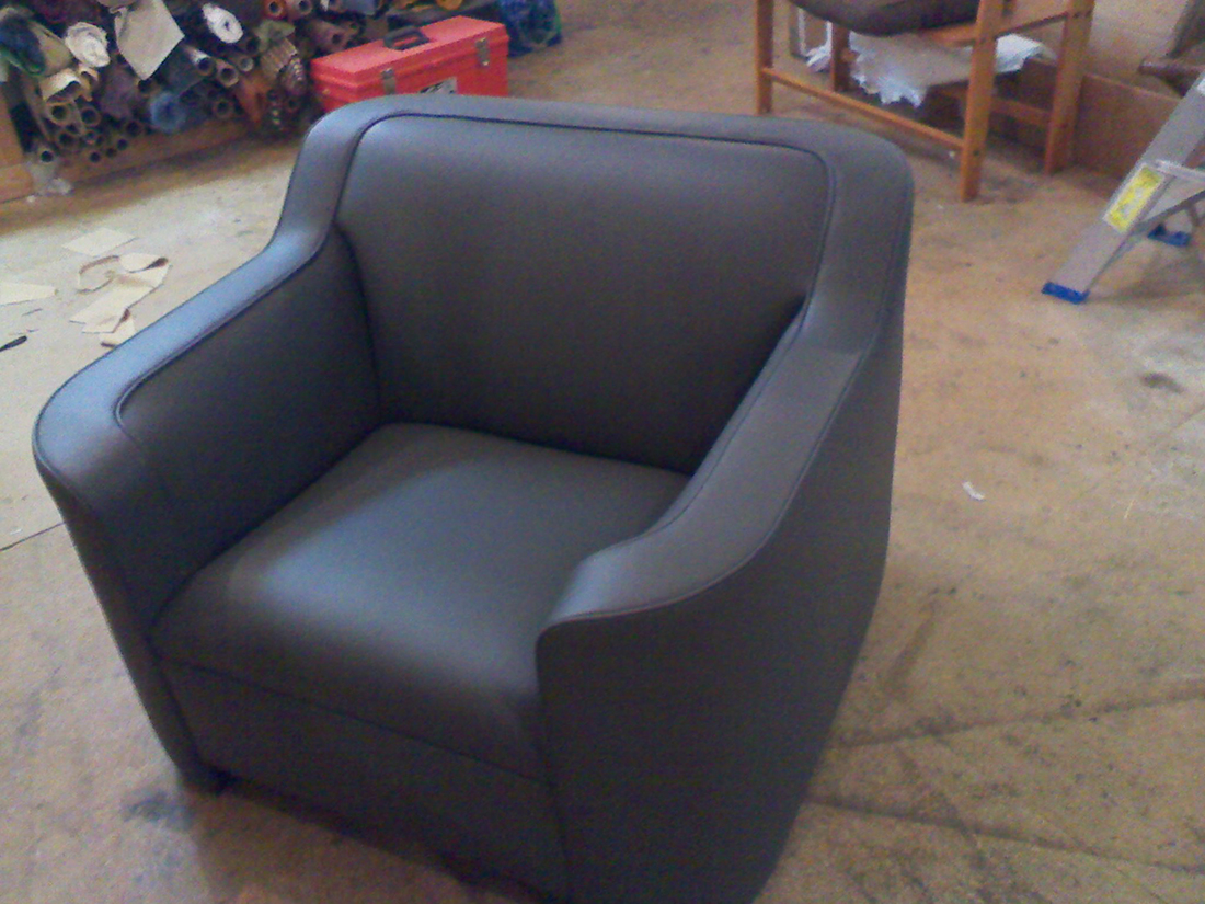 Chair with blue fabric upholstered by Portland Commercial Upholstery