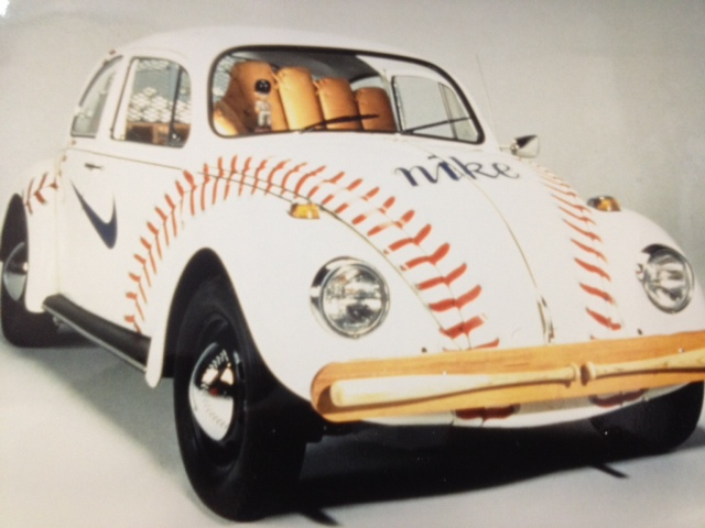 Promotional custom upholstered bug car seat that resembles a baseball glove