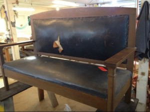 A damaged bench brought to Portland Commercial Upholstery