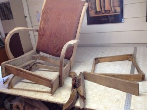 A rocking chair brought in to Portland Commercial Upholstery in need of some serious repair